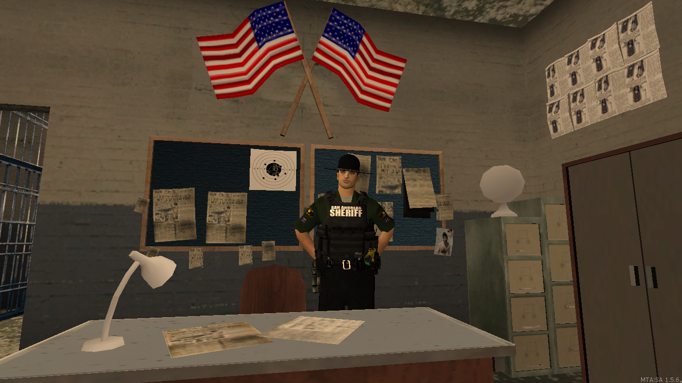 BCSO Sargent doning some paper work. - posted by WolfSchultz